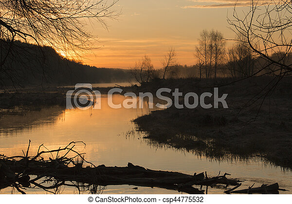 Beginning of sunrise over the river - csp44775532