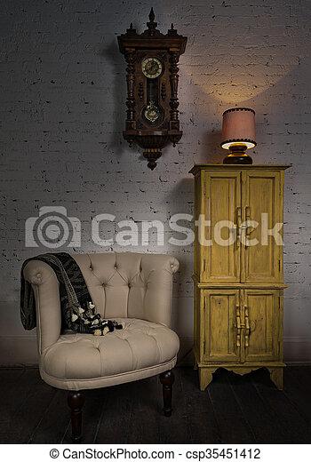 Beige armchair, yellow cupboard, pendulum clock and illuminated table lamp - csp35451412