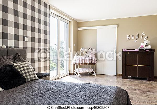 Beige bedroom with a newborn's corner - csp46308207