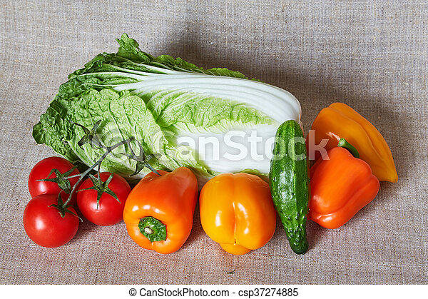 Beijing cabbage, tomato, paprika, cucumber on a gray canvas - csp37274885