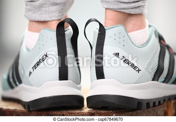 Belarus, Minsk, March 18, 2012. The woman in sneakers Adidas terrex training - csp67849670