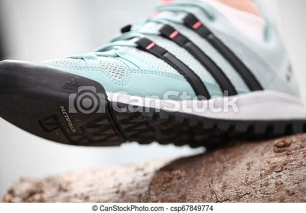 Belarus, Minsk, March 18, 2012. The woman in sneakers Adidas terrex training - csp67849774