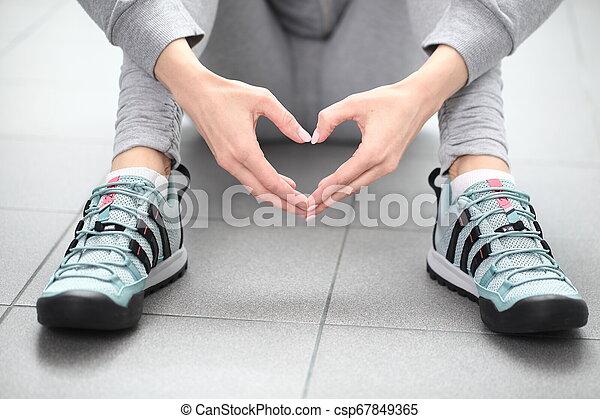Belarus, Minsk, March 18, 2012. The woman in sneakers Adidas terrex training - csp67849365