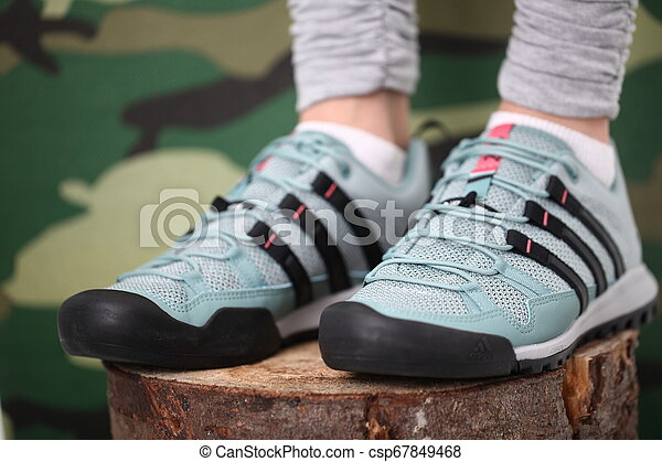 Belarus, Minsk, March 18, 2012. The woman in sneakers Adidas terrex training - csp67849468