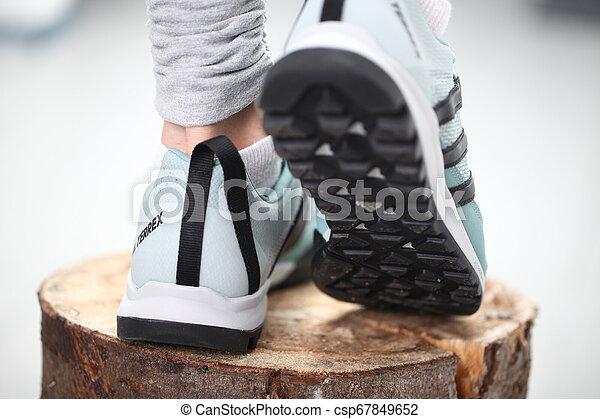 Belarus, Minsk, March 18, 2012. The woman in sneakers Adidas terrex training - csp67849652