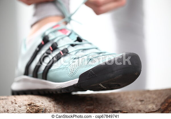 Belarus, Minsk, March 18, 2012. The woman in sneakers Adidas terrex training - csp67849741