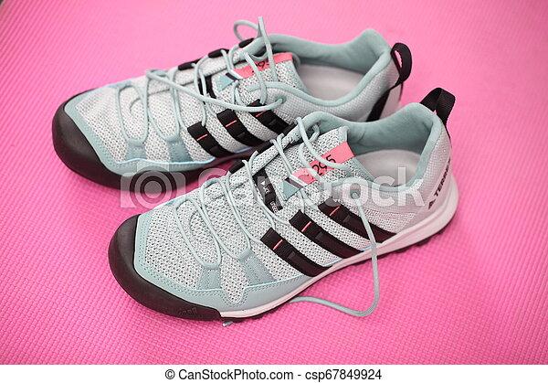 Belarus, Minsk, March 18, 2012. The woman in sneakers Adidas terrex training - csp67849924