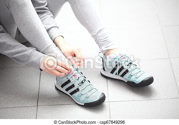 Belarus, Minsk, March 18, 2012. The woman in sneakers Adidas terrex training - csp67849298