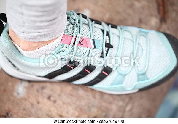 Belarus, Minsk, March 18, 2012. The woman in sneakers Adidas terrex training - csp67849700