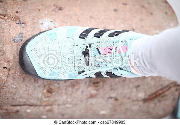 Belarus, Minsk, March 18, 2012. The woman in sneakers Adidas terrex training - csp67849903