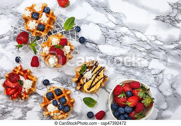 Belgian waffles with berries - csp47392472
