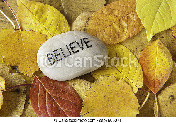 Believe Rock with Fall Leaves - csp7605071