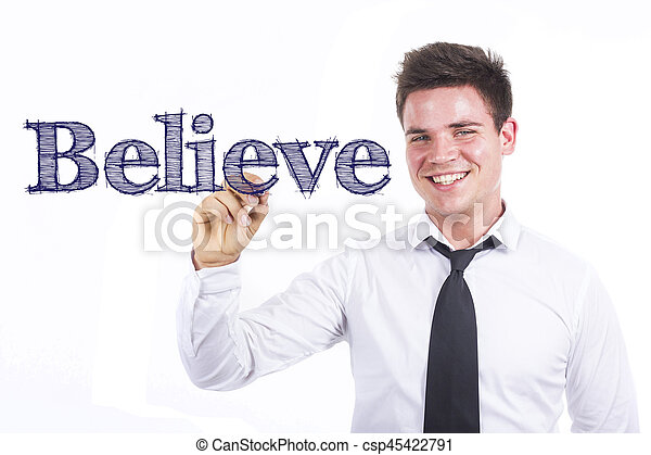 Believe - Young smiling businessman writing on transparent surface - csp45422791