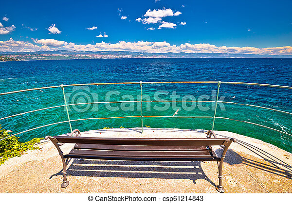 Bench by the sea on Lungomare walkway in Opatija riviera - csp61214843