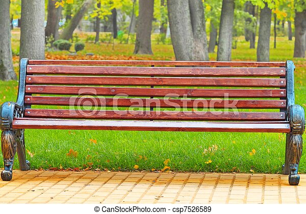 bench in a holiday park in autumn - csp7526589