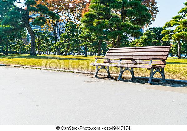 Bench in autumn park - csp49447174