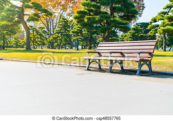 Bench in autumn park - csp48557765