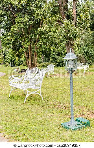 Bench in beautiful garden background.