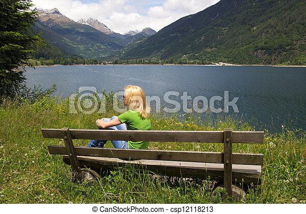 Bench in Swiss Alps - csp12118213