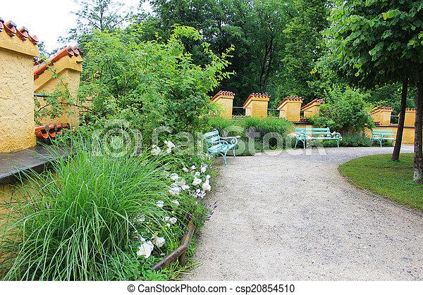 Bench in the garden - csp20854510