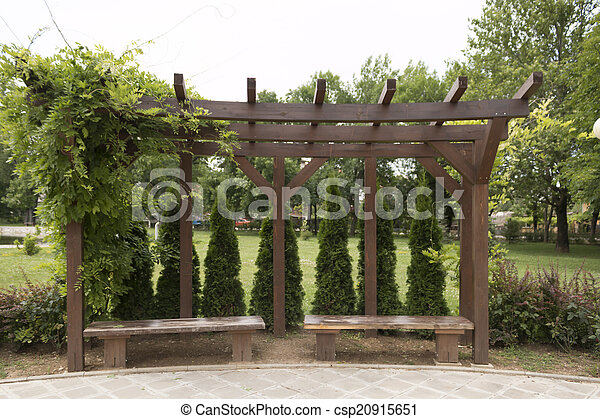 Bench in the garden with many plants - csp20915651