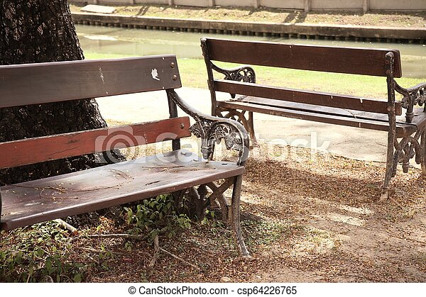 Bench in the park - csp64226765