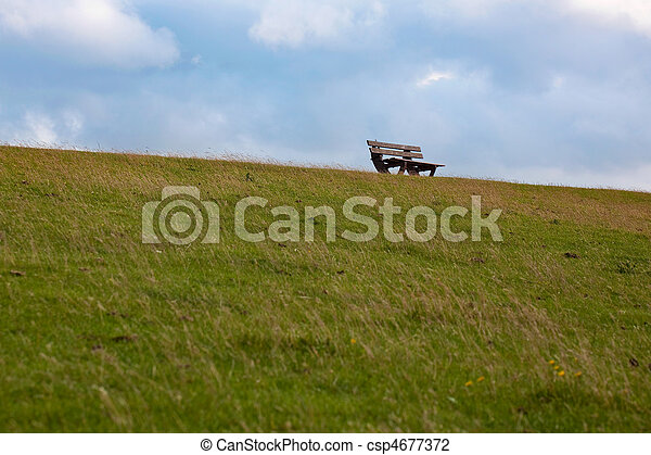 bench on a dike at the north sea - csp4677372