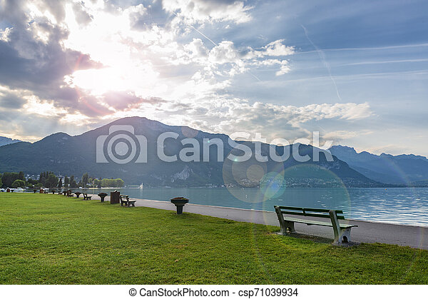 Bench on Annecy Lake in France. - csp71039934