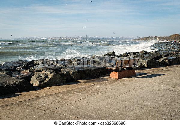 Bench on the coast of Marmara sea in Istanbul, Turkey - csp32568696