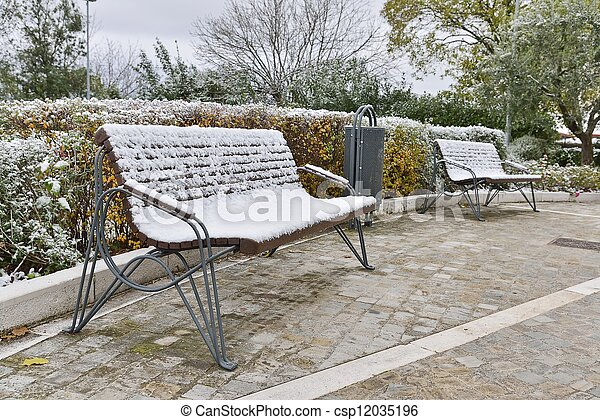 bench with snow in a park - csp12035196