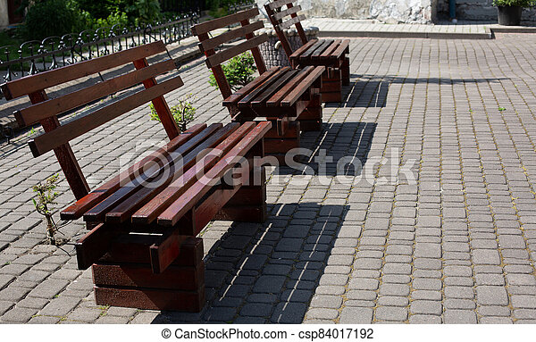Benches on a city square in Lviv - csp84017192