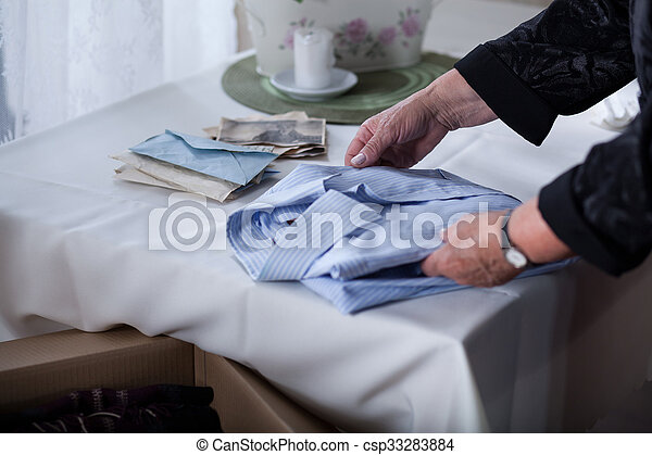 Bereaved female tidying things  - csp33283884