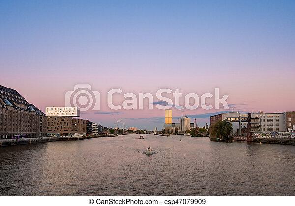 Berlin skyline -  river spree panorama, boats and sunset sky - csp47079909