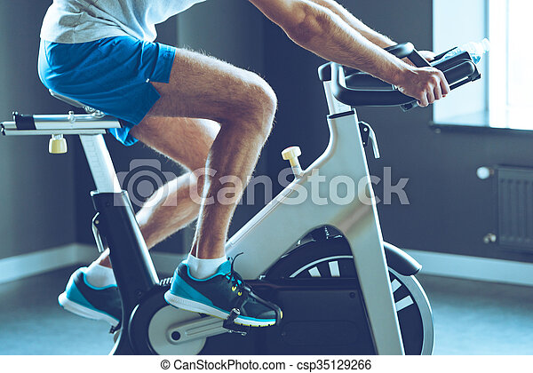 Best Cardio Workout Side View Part Of Young Man In Sportswear Cycling At Gym