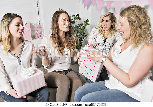 Some Best Friends On Baby Shower Party Celebrating Giving Kid Stuff As Present