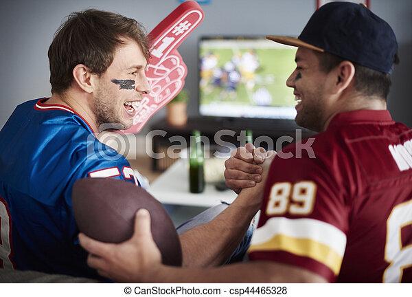 Best mates cherring after their team scores - csp44465328