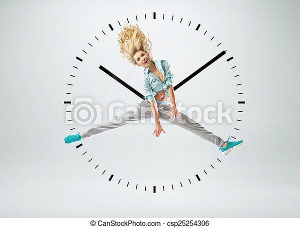 Beuatiful woman as a human clock - csp25254306