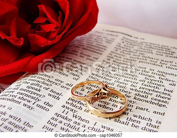 Bible and wedding rings Closeup of bible wedding rings