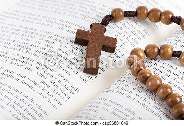 Bible with rosary - csp36801049