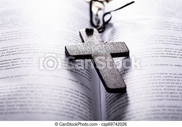 Bible With Wooden Cross - csp69742026