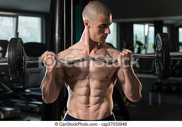 Biceps Exercise With Barbell - csp37033948
