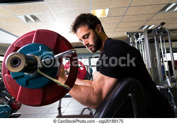 biceps preacher bench arm curl workout man at gym - csp20189175