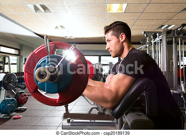 biceps preacher bench arm curl workout man at gym - csp20189139