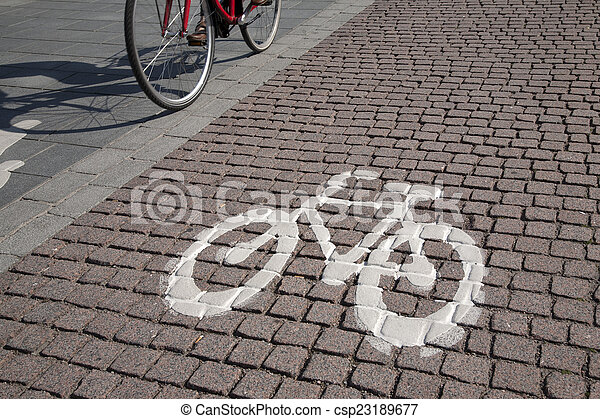 Bicycle and Bike Symbol Sign on Street, Helsinki - csp23189677