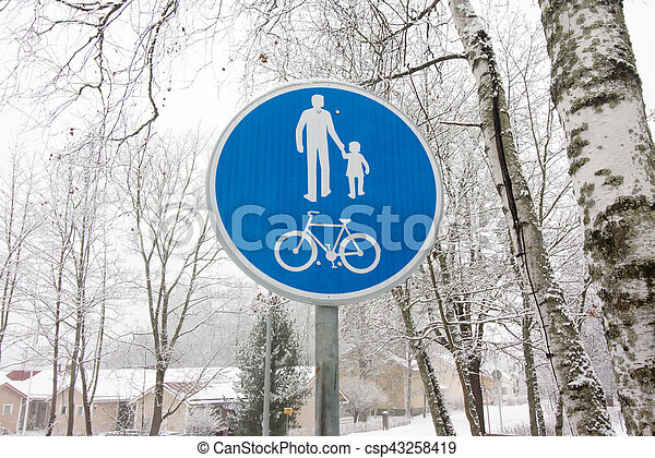 Bicycle and pedestrian lane road sign on pole post. - csp43258419