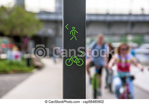 Bicycle and pedestrian lane sign - csp58480902