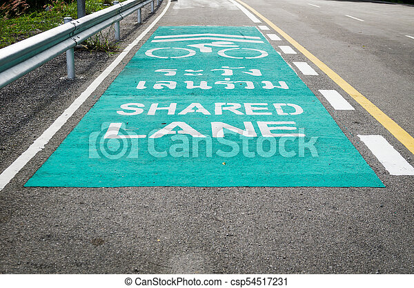 Bicycle Lane Symbol With Green Beside Main Road Bike Lane Symbol