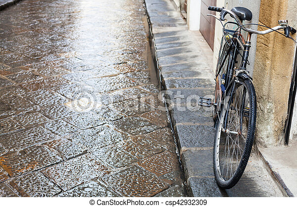 bicycle on wet street in Florence city in rain - csp42932309