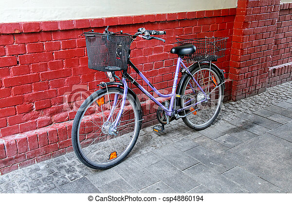 Bicycle parked by the brick wall in Wiesbaden, Hesse, Germany. Wiesbaden is one of the oldest spa towns in Europe