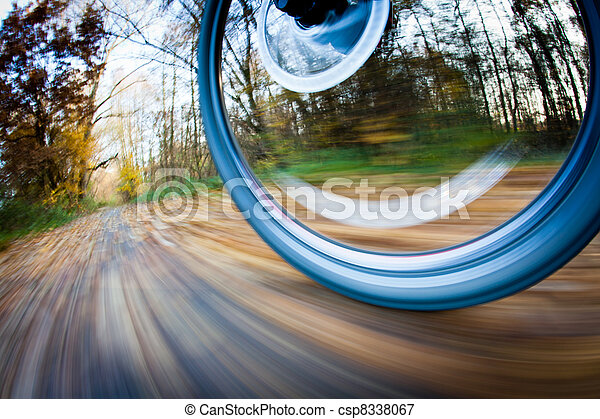 Bicycle riding in a city park on a lovely autumn/fall day  - csp8338067